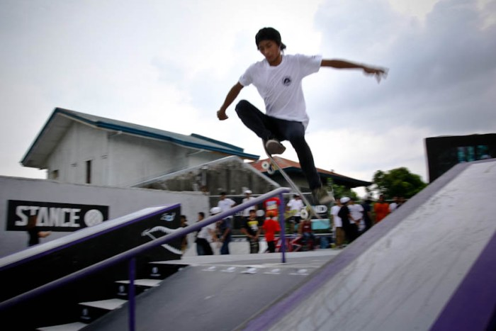 A skater takes off and attempts to skid down the inclined rail inside the Backyard Skatepark in Sta. Rosa, Laguna. Photo by: Chris Quintana