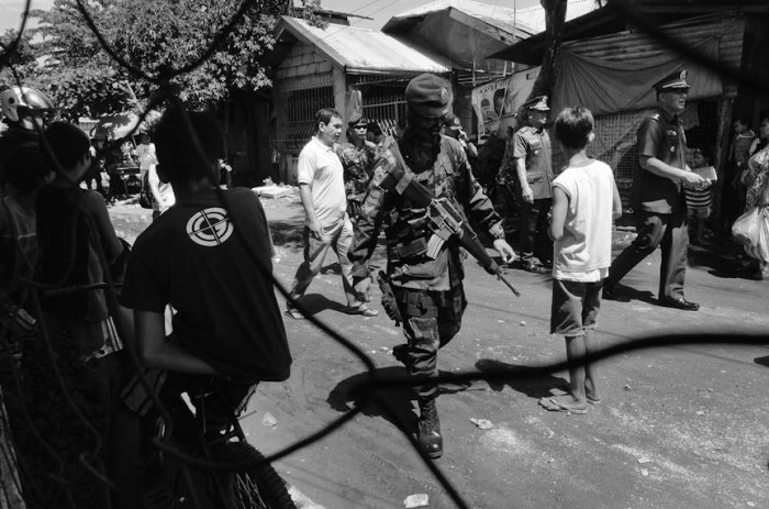 Residents come out to watch barangay officials and police authorities conduct Oplan TokHang in a farflung barangay in Tarlac City. Photo by: Dax Simbol.