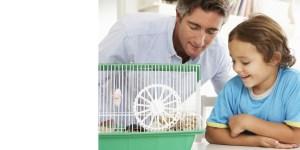 Child and Dad with pet cage