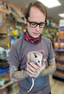 TJ and pet opossum from The Animal Store