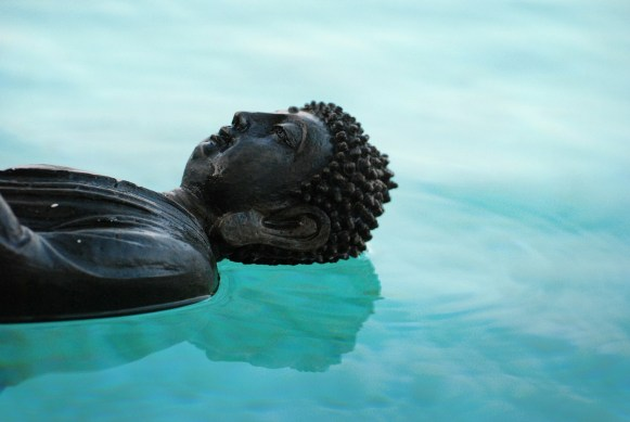 Buddha floating on water.