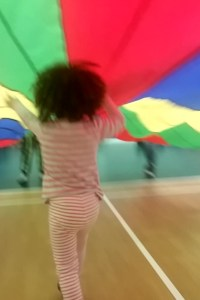 The Phoenix class dancing to music with a parachute.