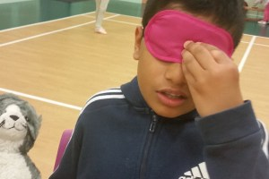 The Phoenix class playing a drama game called 'Cyclops' (which practices their listening skills).