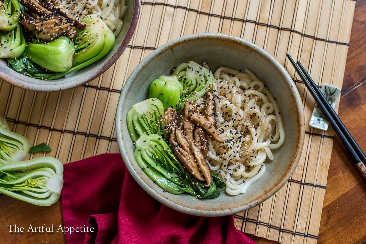 This recipe for Sesame Udon with Braised Bok Choy and Mushrooms takes fewer than 20 minutes to make and is satisfying and delicious! Recipe from The Artful Appetite