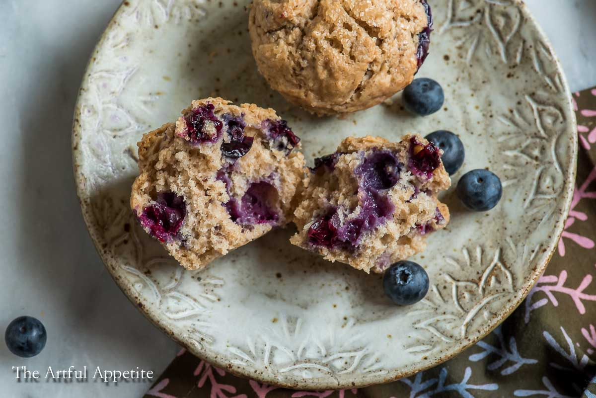 Vegan blueberry muffins are a delicious summer breakfast or snack, especially when you can get freshly picked wild blueberries! Recipe from The Artful Appetite.