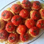 Baked Rice Stuffed Tomatoes - Pomodori al Riso is a beloved Roman summer dish featuring intensely flavored tomatoes filled with garlic and herb scented rice then baked until wrinkly on a sea of golden potatoes. Simply deliziosi!