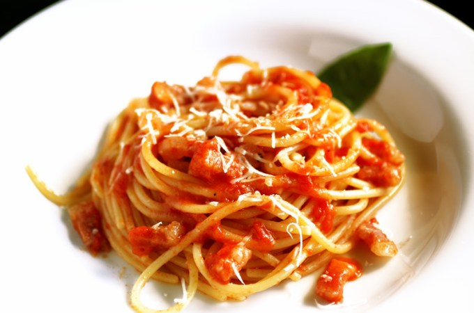 Spaghetti all'Amatriciana - This world reknowned dish hails from the town of Amatrice and was adopted by Rome as one of its signature dishes. It's made with cured pork jowl bacon, tomatoes, garlic and - of course - spaghetti or bucatini. Simply deliziosa!