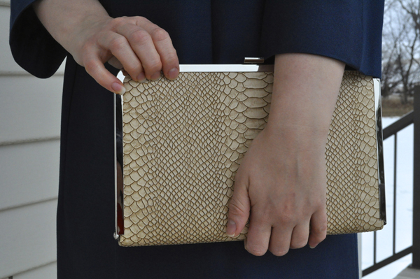 the artyologist- image of a tan faux snakeskin clutch