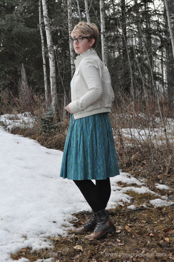 the artyologist- image of a spring outfit with a white faux leather coat and vintage 1950's dress