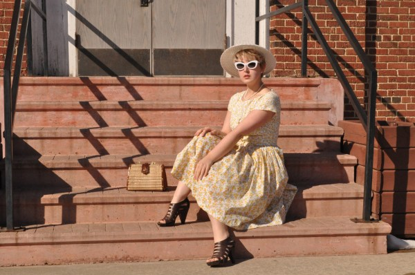 theartyologist image of vintage vogue 1044 easter dress and white sunglasses sitting on steps of school
