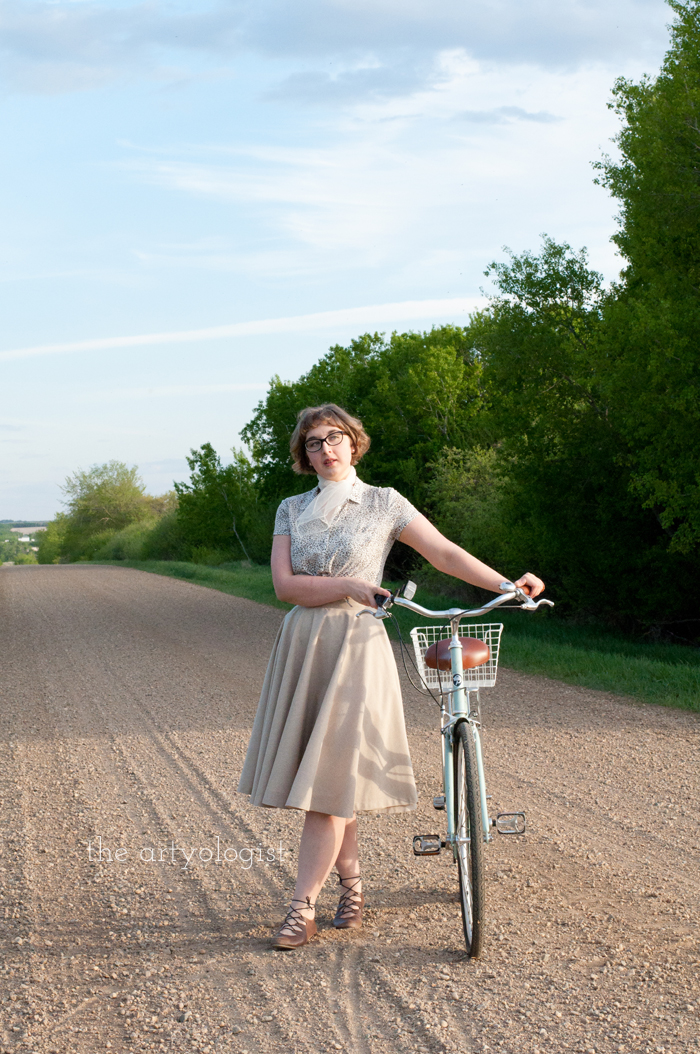 Rural Holiday, the artyologist, a roman holiday outfit, sunny-standing-beside-bicycle