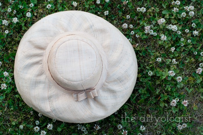 Amongst the Clover, the artyologist, straw sun hat in clover