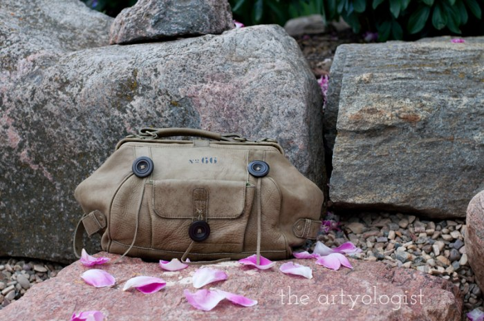 olive green doctors bag purse-on-rocks, the artyologist