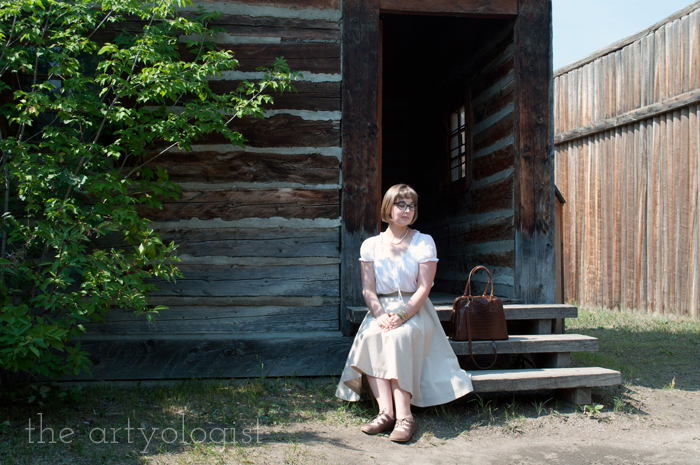 A Period Incorrect Outfit at Heritage Park , sitting on step, the artyologist