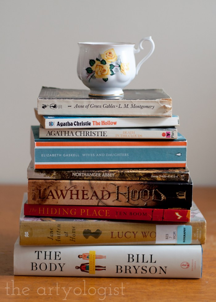 stack of books with a teacup on top