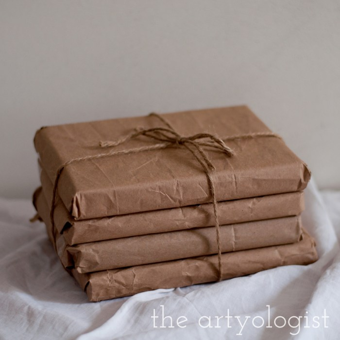 a stack of books tied up in brown paper and twine