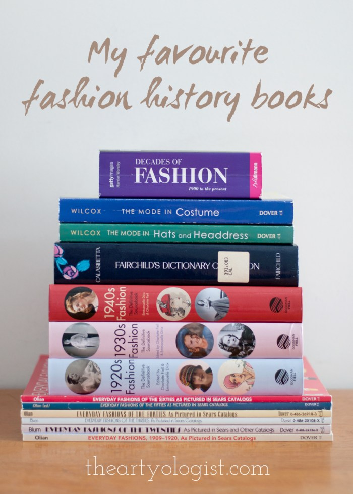 a tall stack of fashion history related books