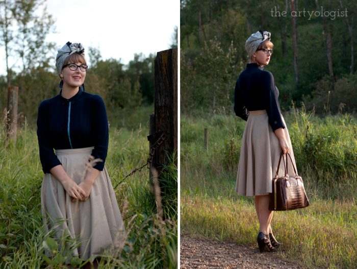 woman wearing a vintage and modern styled outfit of a tan circle skirt, navy blouse and a silk scarf turban.