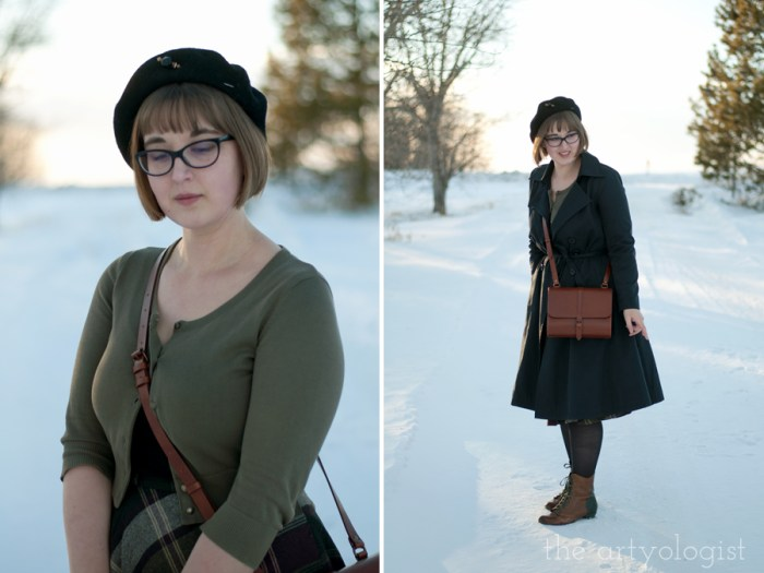 a lady wearing a vintage styled outfit with a plaid skirt, cardigan and beret on a winter day