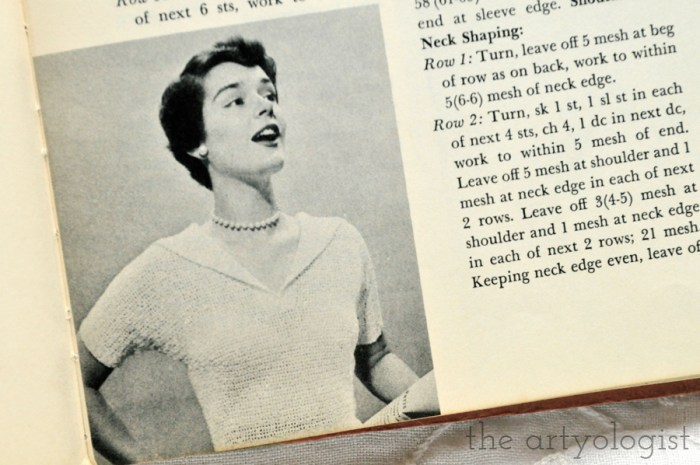 lady wearing a vintage hooded short sleeved sweater