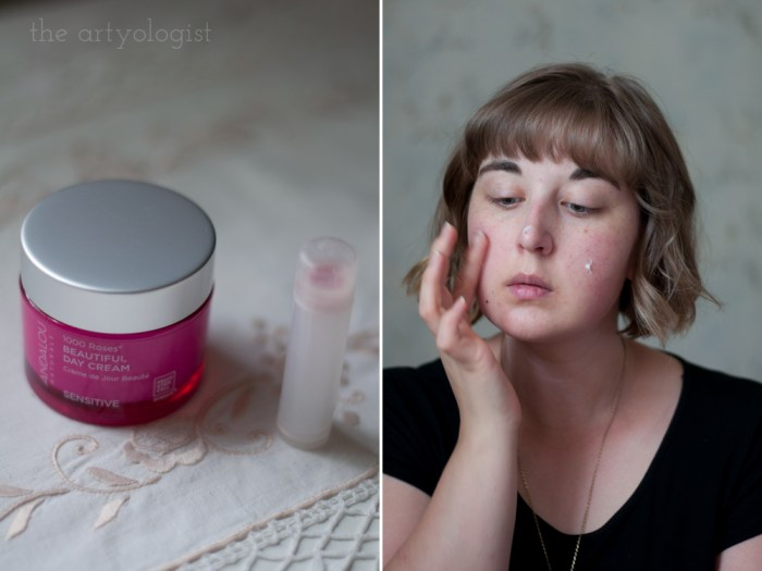 woman putting face lotion on