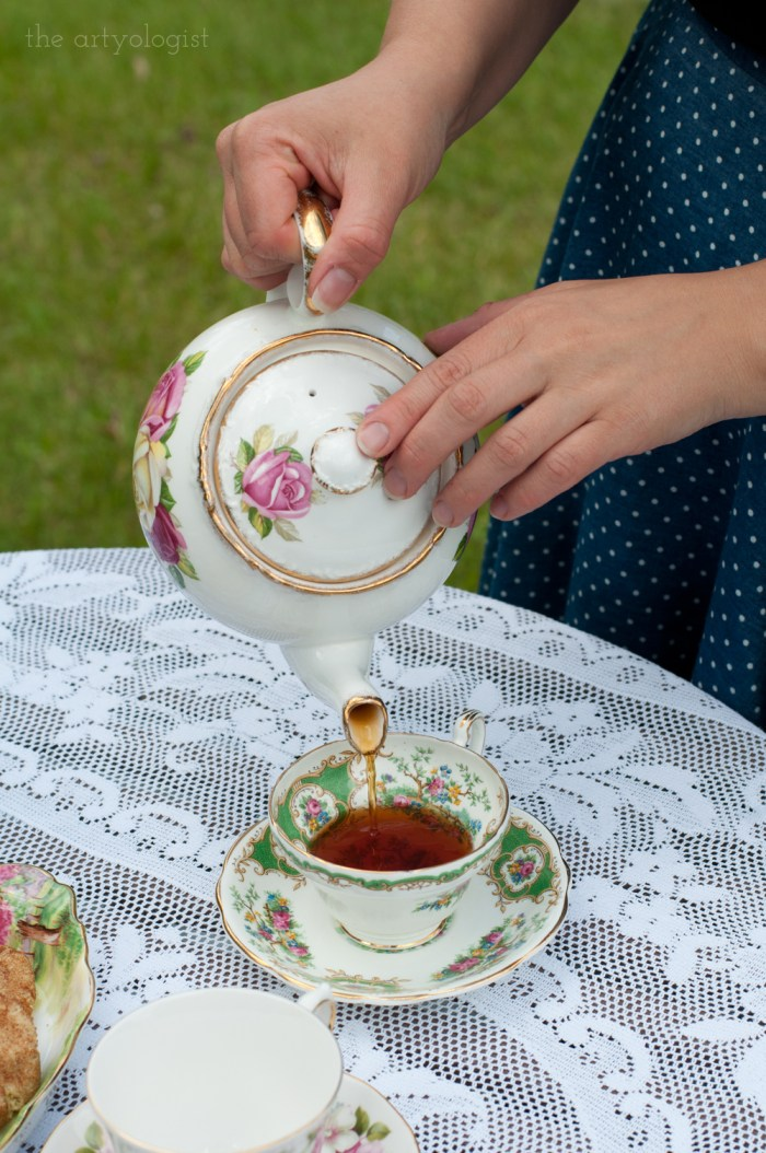 pouring a cup of earl grey into a teacup