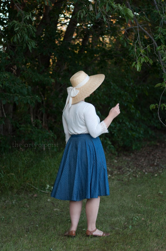 woman wearing a wrap skirt large straw hat