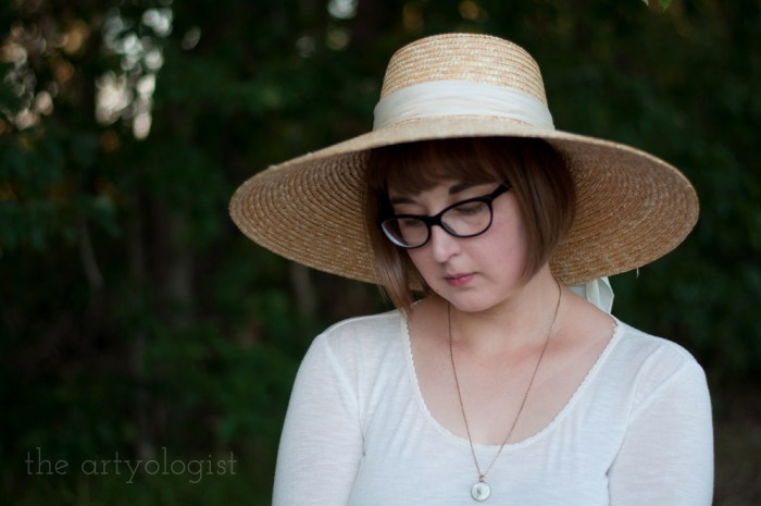 woman wearing a large straw hat