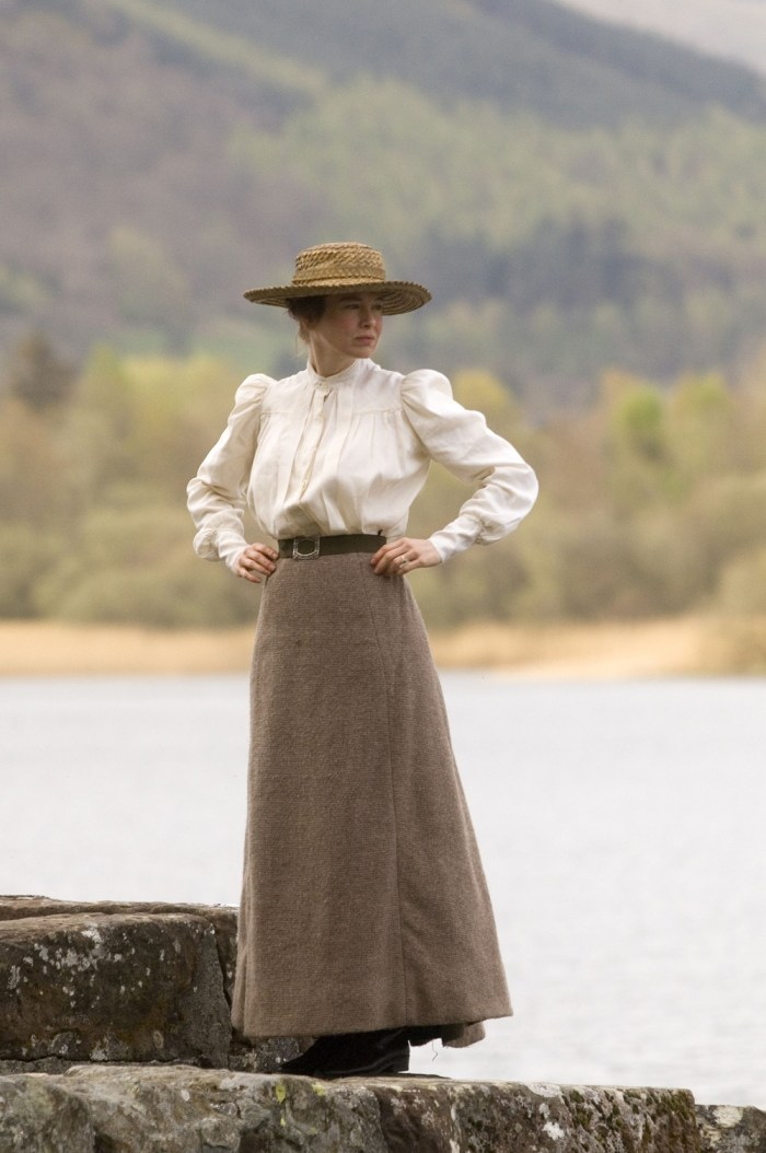 miss potter standing by the lake