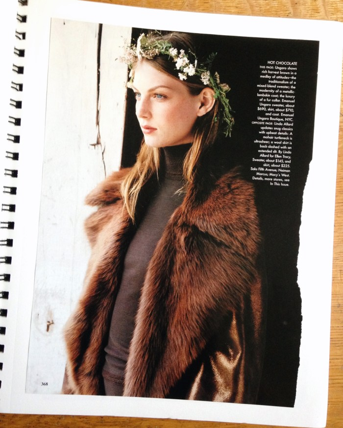 Vogue 1998 photo of a girl wearing a fur coat and a flower crown looking out a window