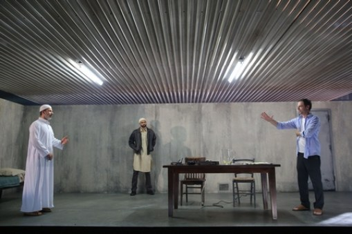"Dariush Kashani, Usman Ally and Justin Kirk in a scene from ""The Invisible Hand"" (Photo credit: Joan Marcus)"