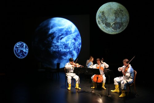 "Ensemble for the Romantic Century's violinist Sean Lee, pianist Eve Wolf, cellist Jiyoung Lee and violist Andrew Gonzalez in a scene from ""Jules Verne: From the Earth to the Moon"" (Photo credit: Joan Marcus)"