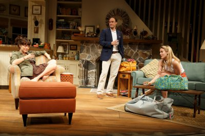 "Heather Lind, Greg Keller and Alicia Silverstone in a scene from ""Of Good Stock"" (Photo credit: Joan Marcus)"
