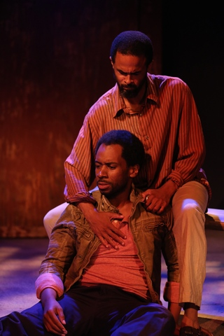 "Joshua David Robinson (on ground) and Danyon Davis (above) in a scene from Ken Urban's ""Sense of an Ending"" (Photo credit: Carol Rosegg)"