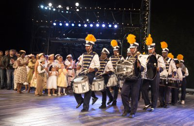 """Company members and The Marching Cobras in a scene from The Public Theater's free Public Works production of """"The Odyssey"""" (Photo credit: Joan Marcus)"""