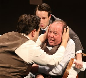 "Daniel Kahn as Biff , Lev Hershkovitz as Happy and Avi Hoffman as Willy in a scene from New Yiddish Rep's ""Death of a Salesman"" in Yiddish (Photo credit: Ronald L. Glassman)"
