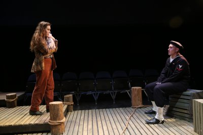 """Lucy Lavely and Derek Grabner in a scene from """"The Widow of Tom's Hill"""" (Photo credit: Carol Rosegg)"""