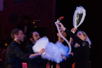 """Puppeteers with """"The Swan"""" in a scene from """"The Carnival of the Animals"""" at Miller Theatre (Photo credit: Karli Cadel)"""