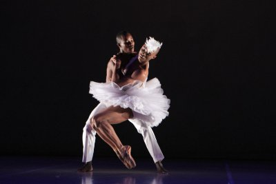 "Songezo Mcilizeli as Siegfried and Dada Masilo as Odette in a scene from ""Swan Lake"" (Photo credit: John Hogg)"