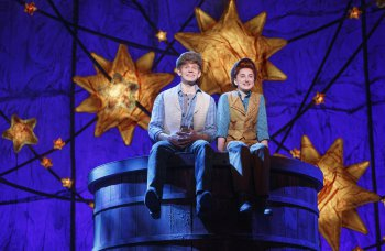 "Andrew Keenan-Bolger as Jesse Tuck and Sarah Charles Lewis as Winnie Foster in a scene from ""Tuck Everlasting"" (Photo credit: Joan Marcus)"