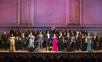 "Soloists and Essential Voice USA with music director Steven Reineke on the podium in The New York Pops's 33rd Birthday Gala entitled "" Do You Hear the People Sing"" (Photo credit: Richard Termine)"