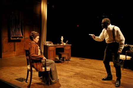 "Maggie Lacey as Laura and John Douglas Thompson as The Captain in a scene from Strindberg's ""The Father"" (Photo credit: Gerry Goodstein)"