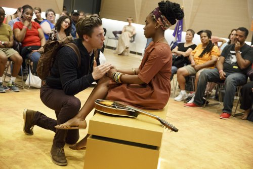 """Christian DeMarais and Kristolyn Lloyd in a scene from Mobile Unit's """"Hamlet"""" now at the Public Theater (Photo credit: Joan Marcus)"""