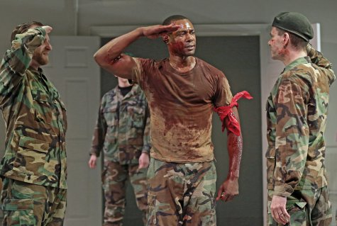 "Zachary Fine, Dion Johnstone and Aaron Krohn in a scene from Red Bull Theater's revival of ""Coriolanus (Photo credit: Carol Rosegg)"