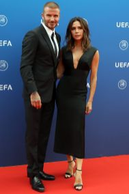 David e Victoria Beckham, in una sua creazione, all'UEFA Champions League football tournament.