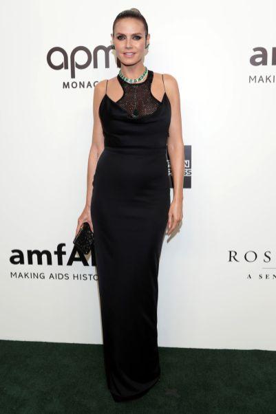 Heidi Klum in Versace, scarpe Jimmy Choo e gioielli Lorraine Schwartzall'amfAR event.