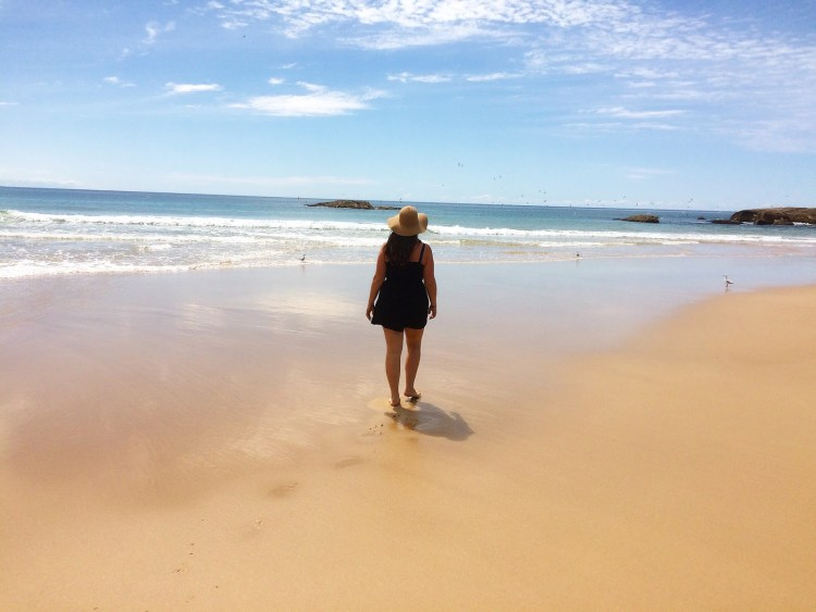 Girl walking on beach in Australia