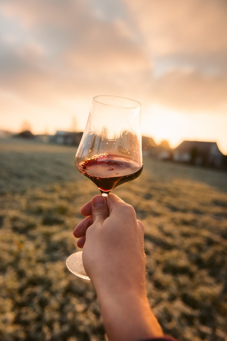 Holding Wine Glass at Sunset