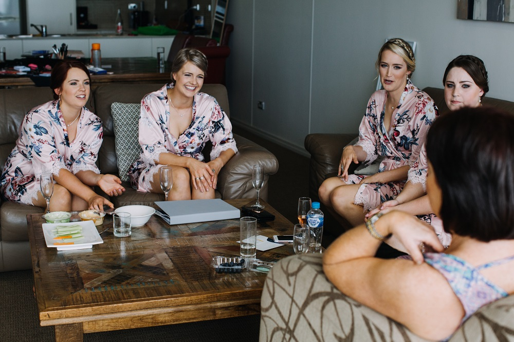 Bridal party relaxing in robes