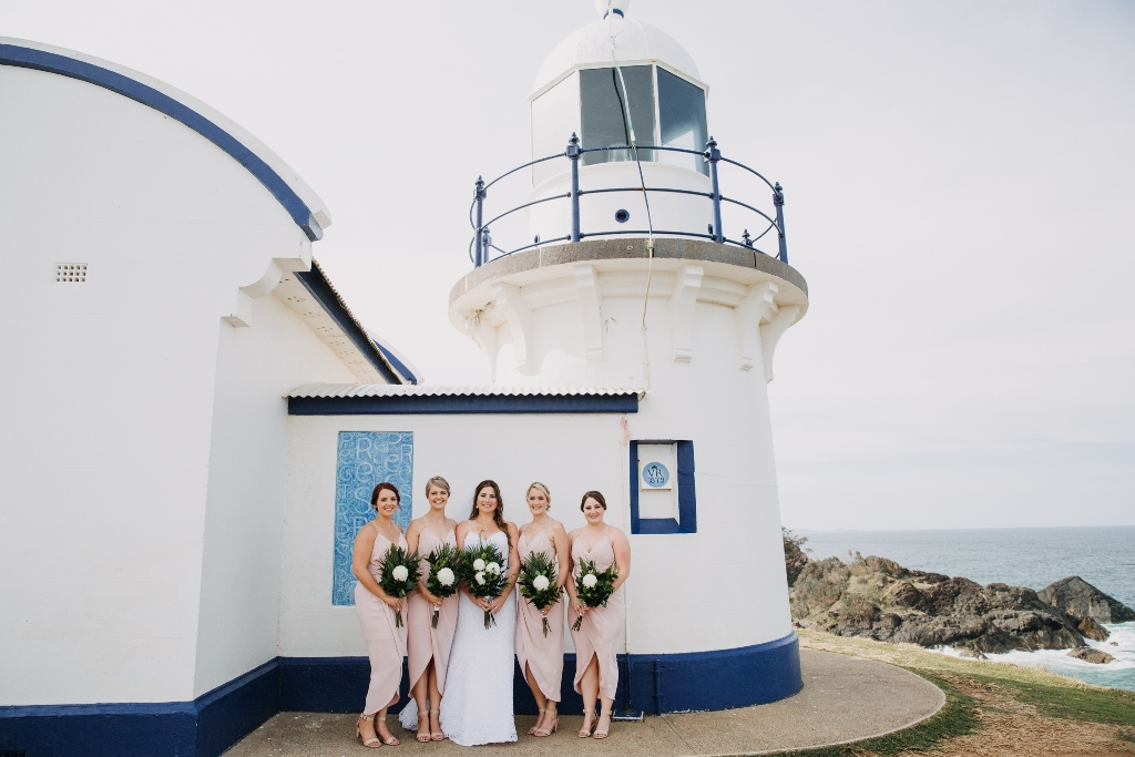 Bride and Bridesmaids standing in front of Tacking Point Lighthouse Port Macquarie